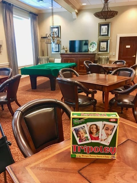"Fun & Friendship: Residents at The Terraces are dealt a hand of happiness  with the game ""Tripoley"""